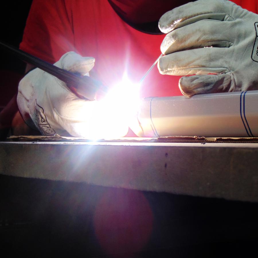 Worker welding aluminum